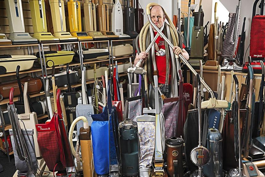 British man James Brown poses with his record-breaking collection of vacuum cleaners. -- PHOTO: AFP / GUINNESS WORLD RECORDS / RANALD MACKECHNIE