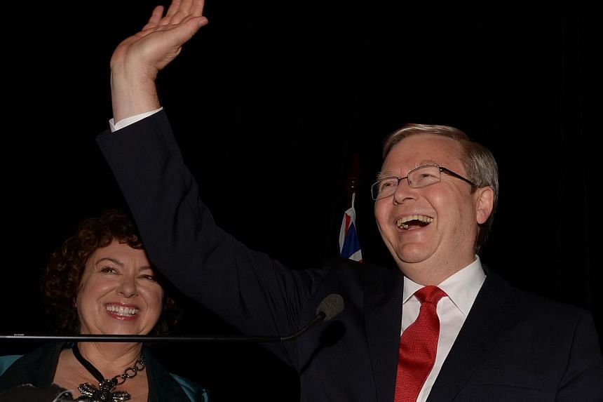 Australian Prime Minister Kevin Rudd (right) with his wife Therese Rein (left) wave to supporters as he concedes defeat while speaking at a Labor party function in Brisbane on Sept 7, 2013. Former Australian prime minister Kevin Rudd plans to make a