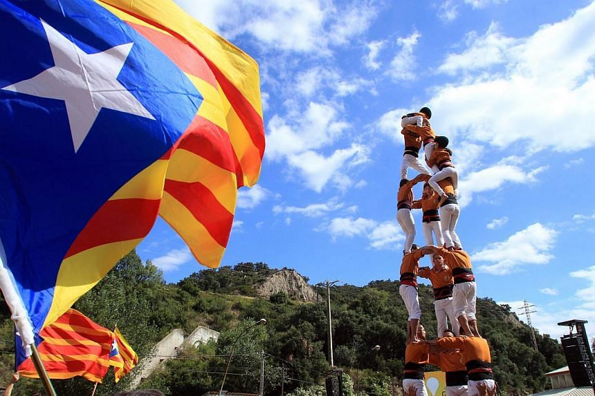 Activists calling for the independance of Catalonia, currently a region of Spain, are seen after taking part in a 'human chain' during a protest on Sept 11, 2013, in Perthus, southern France. Independence-seeking Catalans marshalled their forces toda