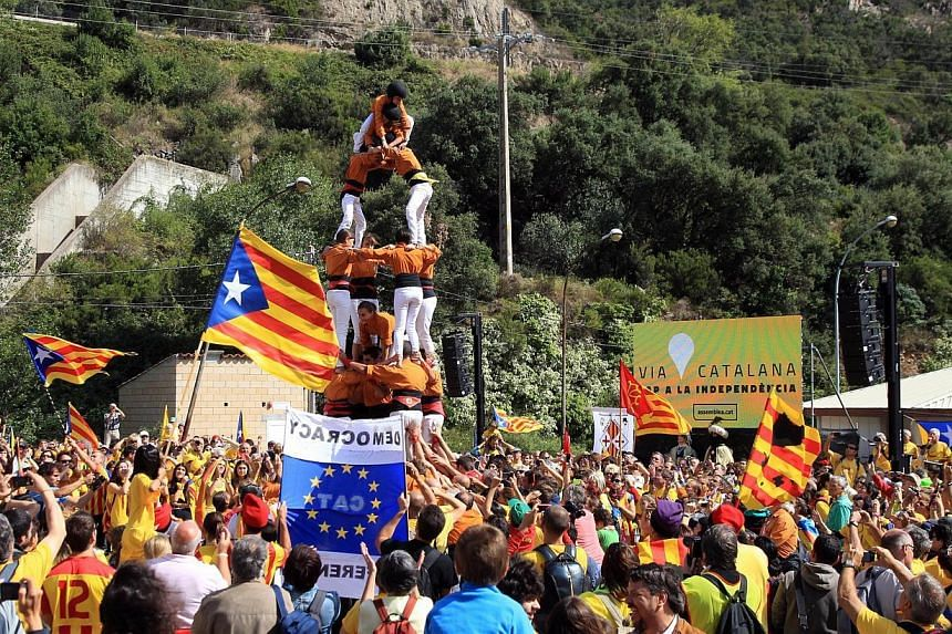 Activists calling for the independance of Catalonia, currently a region of Spain, form a human pyramid during a protest on Sept 11, 2013, in Perthus, southern France. Independence-seeking Catalans marshalled their forces today for a 400km human chain