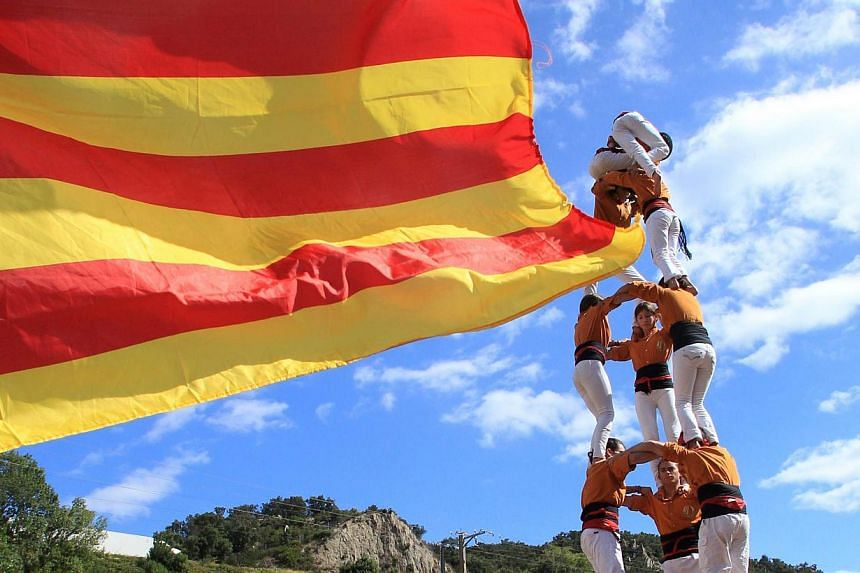 Activists calling for the independance of Catalonia, currently a region of Spain, form a human pyramid during a protest on Sept 11, 2013, in Perthus, southern France. Independence-seeking Catalans marshalled their forces today for a 400km human