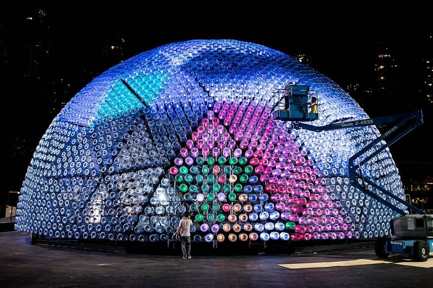 A giant lantern has been constructed out of 7,000 recycled plastic bottles and other recyclable materials in Hong Kong. -- PHOTO: AFP