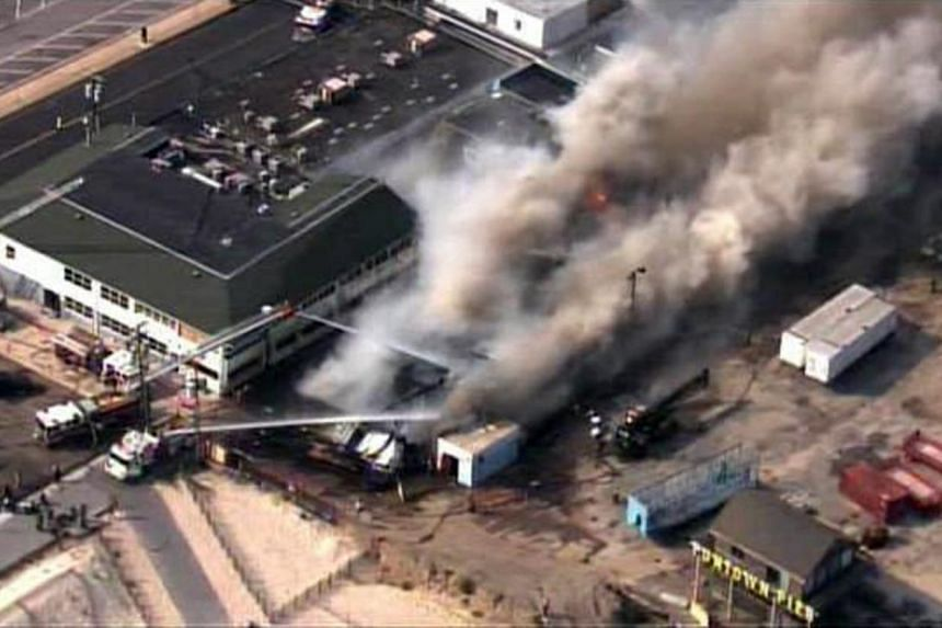 In this aerial image taken from video and provided by Fox 29, firefighters battle a raging fire on boardwalk in Seaside Heights, New Jersey, on Sept 12, 2013.  Fire torched the New Jersey boardwalk that survived Hurricane Sandy. -- PHOTO: AP