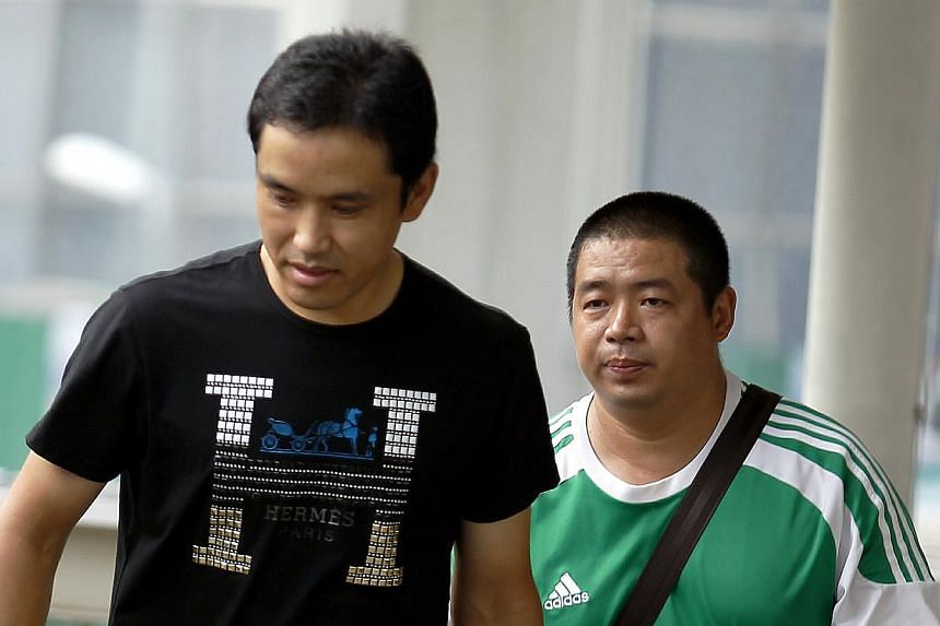 (From left) Chinese nationals Yang Dong and Wu Delong were each sentenced to 11 weeks' jail for commercial sex with a 17-year-old girl from China. -- ST PHOTO: WONG KWAI CHOW