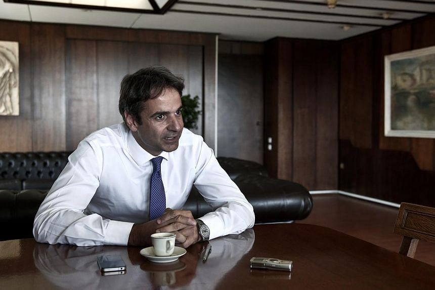 Greece's Administrative Reform minister Kyriakos Mitsotakis speaks during an interview with Reuters in Athens July 31, 2013. Greece's austerity drive has cost public Sector workers a privilege they have enjoyed for more than two decades - six extra d