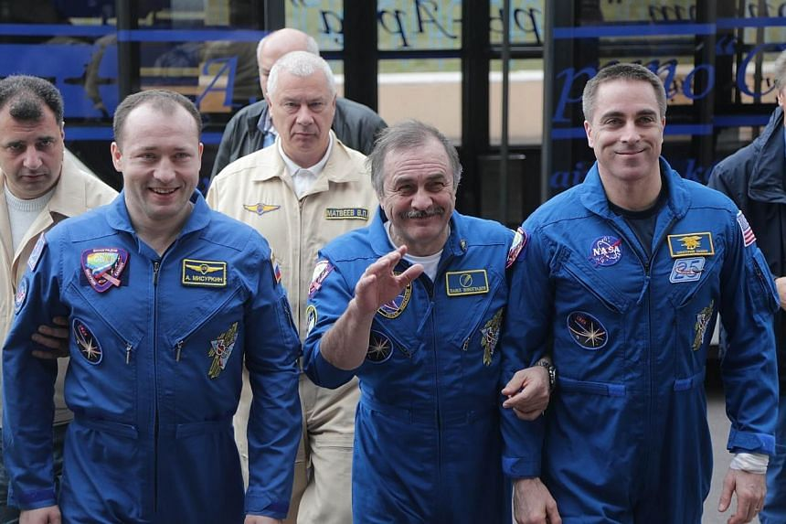 Russian cosmonauts Alexander Misurkin (from left) and Pavel Vinogradov and US astronaut Chris Cassidy arrive for a press conference at the Karaganda airport in Kazakhstan, on Wednesday, Sept 11, 2013.The three crew of the International Space St