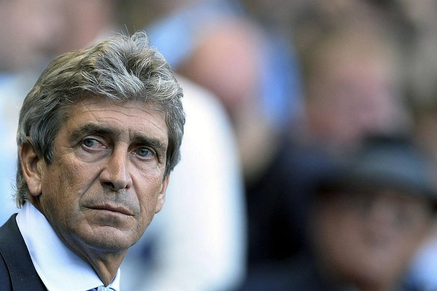 Manchester City manager Manuel Pellegrini believes a run of seven matches in the next 21 days before the next international football break will offer a major test of his team's credentials. -- FILE PHOTO: REUTERS