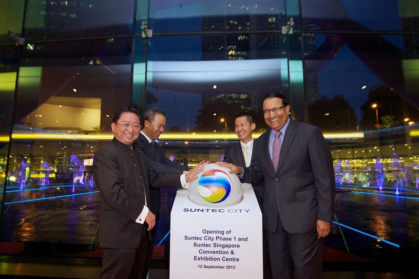 The revamped Suntec City Mall (above) opened yesterday, in time for next week's Formula One race. At the ceremony (below) held at the mall's Fountain of Wealth were (from left) Mr John Lim, CEO of ARA Asset Management, Mr Ng Lang, CEO of URA, Mr Lion