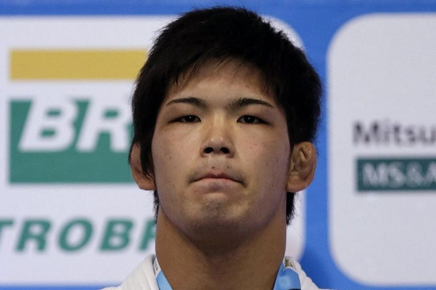 World judo champion Shohei Onofrom Japan poses with his gold medalafterwinning the 73kg title at last month's world championships in Rio de Janeiroin Rio de Janeiro, on Aug 28, 2013. Shohei Ono has been suspended from his univ