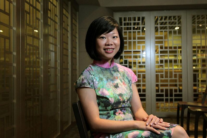 Teaching and learning two languages is affected by social and cultural developments, Minister of State for Education, and Communications and Information, Sim Ann (above) said on Friday, Sept 13, 2013. -- ST FILE PHOTO: SEAH KWANG PENG
