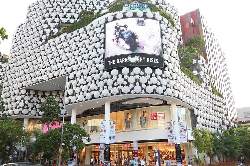 CapitaLand's Bugis+ received a BCA Green Mark Platinum rating in 2012. For the first time in its green-building drive, the Building and Construction Authority plans to ask building owners to make their energy performance data public. -- FILE PHOTO: