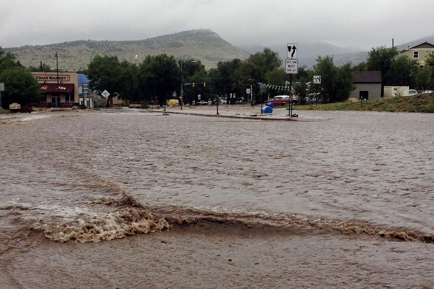 This image provided by Jason Stillman shows flooding in Lyons, Colorado, on Sept 12, 2013. Boulder County Sheriff Joe Pelle said the town of Lyons was completely cut off because of flooded roads. -- PHOTO: AP