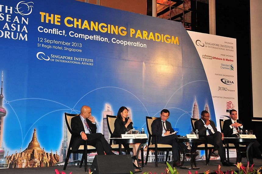 Speaking at the 6th Asean and Asia Forum on September 12, 2013 are (from left) Mr Dhaval Buch from Unilever Asia, Ms Sharon Chong from Wilmar International, Dr Simon Tay, Chairman of Singapore Institute of International Affairs, Mr Aba