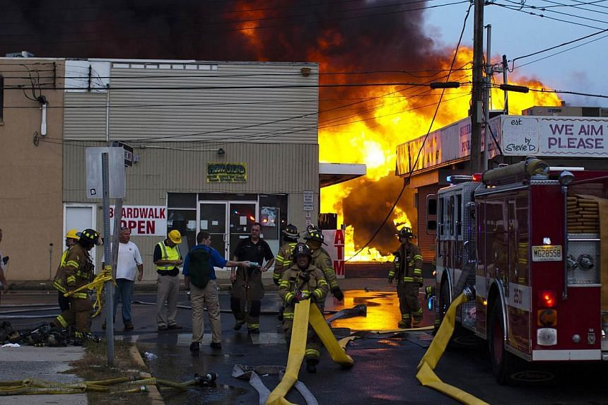 New Jersey firefighters work to control a massive fire in Seaside Park in New Jersey on Sept 12, 2013. The fire engulfed several blocks of boardwalk and businesses on Thursday in Seaside Park, a shore town that was still rebuilding from damage caused