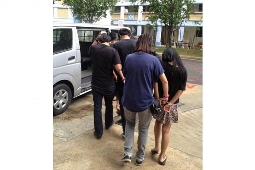 Suspects arrested by CNB. -- PHOTO: SINGAPORE POLICE FORCE