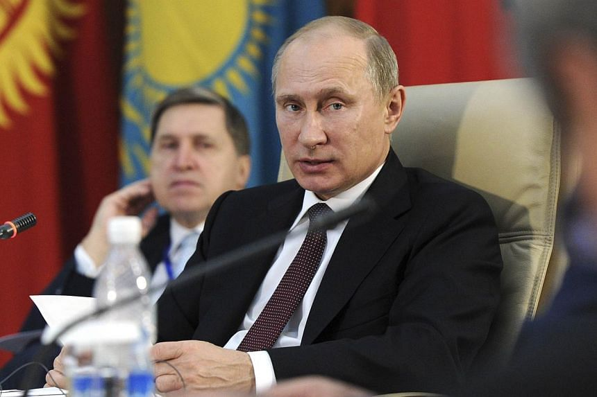 Russia's President Vladimir Putin attends a session during the Shanghai Cooperation Organization (SCO) summit in Bishkek, Kyrgyzstan on Friday, Sept 13, 2013. Putin on Friday said the global community should welcome Syria's decision to