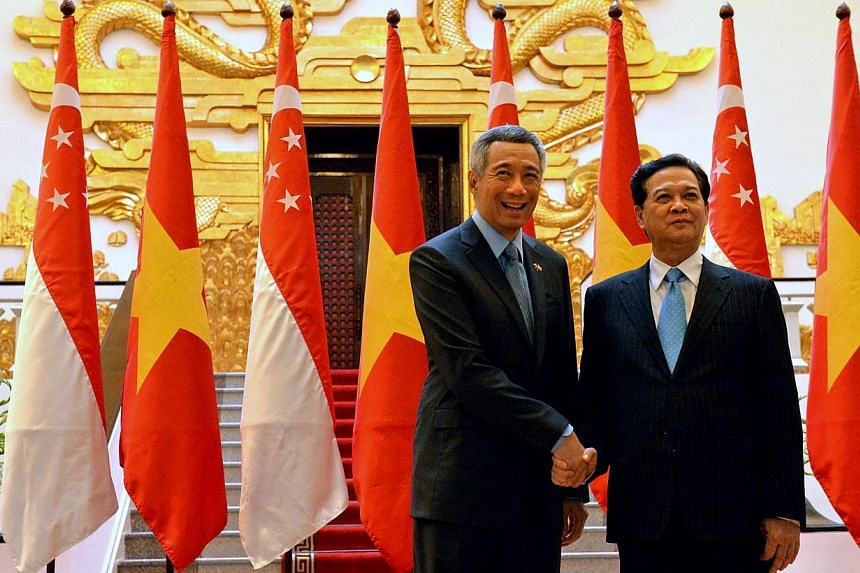 Singapore's Prime Minister Lee Hsien Loong (left) and Vietnamese Prime Minister Nguyen Tan Dung inside the Grand Hall of the Government Office in Hanoi on Sept 11, 2013. Mr Lee and Mr Dung on Sept 13 launched the fifth Vietnam-Singapore Industrial Pa