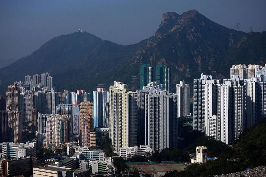 """An elevated view from Fei Ngo Shan Mountain shows residential buildings in the Kowloon region of Hong Kong on Jan 12, 2010. British Foreign Office Minister Hugo Swire said Hong Kong's progress towards universal suffrage was """"vital to its future stabi"""