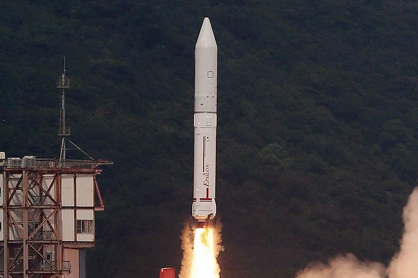 Japan's new solid-fuel rocket launches at Japan Aerospace Exploration Agency's (JAXA) Uchinoura Space Centre in Kagoshima, south-western Japan on Saturday, Sept 14, 2013. -- PHOTO: AFP