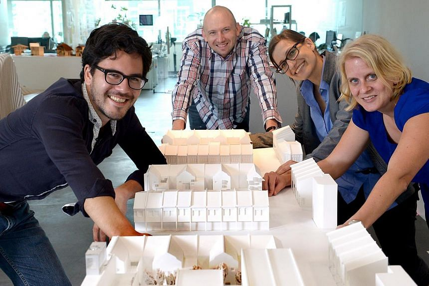 The FCL team behind the Rochor project: (from left) doctoral researchers Marcel Bruelisauer, 31, and Pieter J. Fourie, 39; postdoctoral researcher Iris Belle, 38; and senior researcher Edda Ostertag, 37. They propose integrating multiple air-con unit
