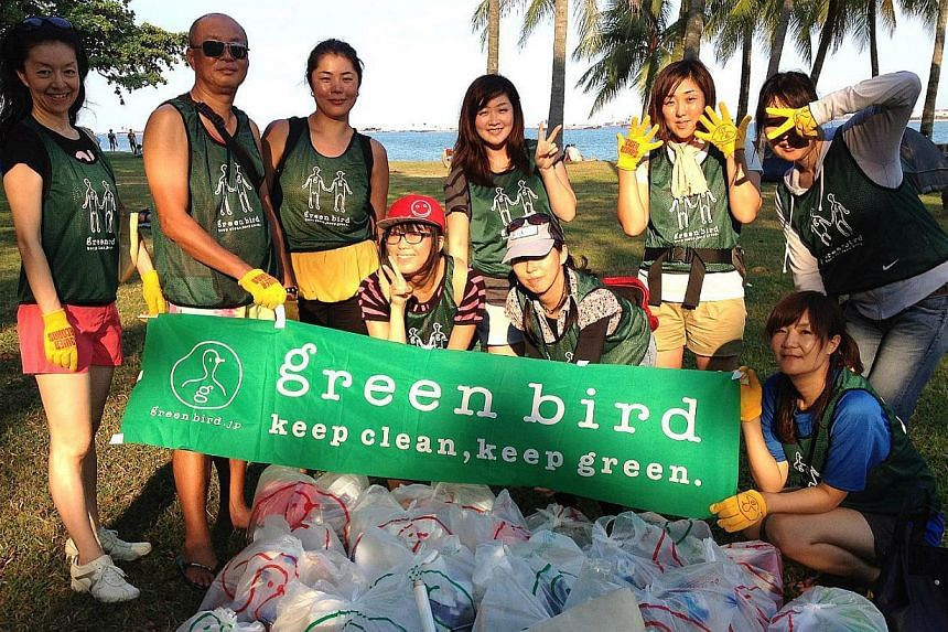 Members of Japanese non-profit environmental group Green Bird with bags of rubbish collected after a litter-picking session at East Coast Park.They will be back at the park on Sept 29.