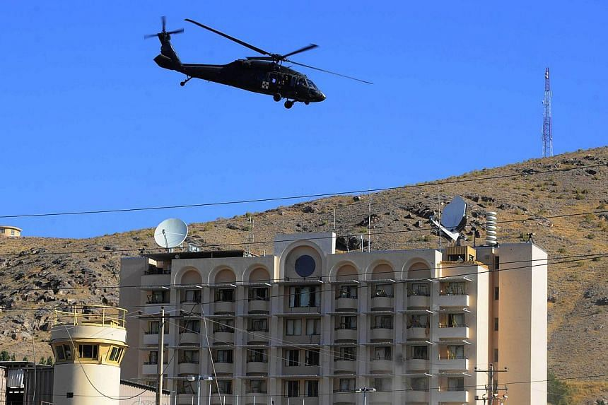 A United States military helicopter flies overhead during an attack on the US consulate in Herat on Sept 13, 2013.Pentagon officials are holding talks in Afghanistan on the withdrawal of US military equipment from the country, officials said on