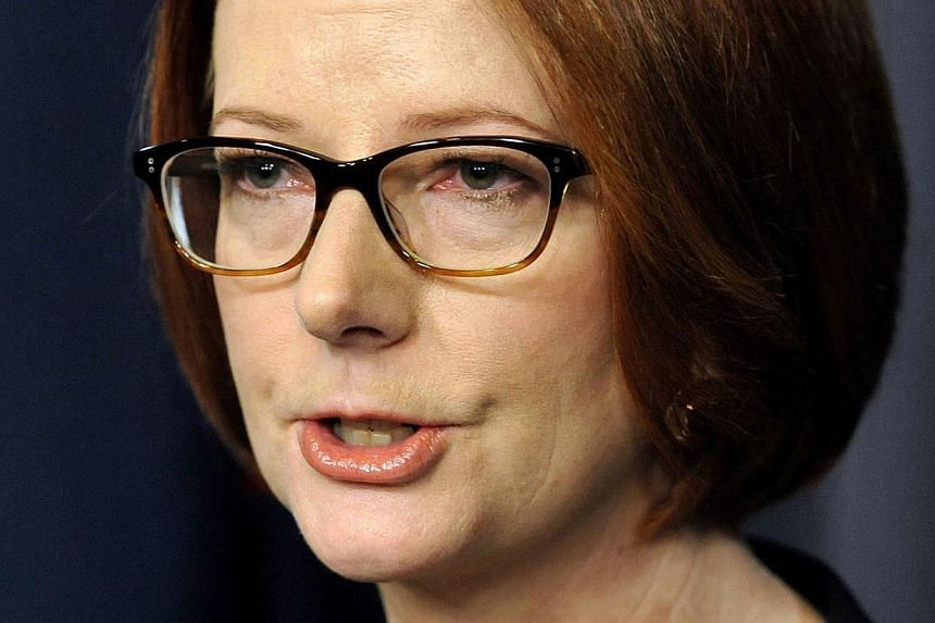 "A file photo taken on June 26, 2013 shows former Australian Prime Minister Julia Gillard speaking to the media after her defeat in a party room vote, in Canberra.Losing power was like being ""hit by a fist"", Australia's first female prime minister Jul"