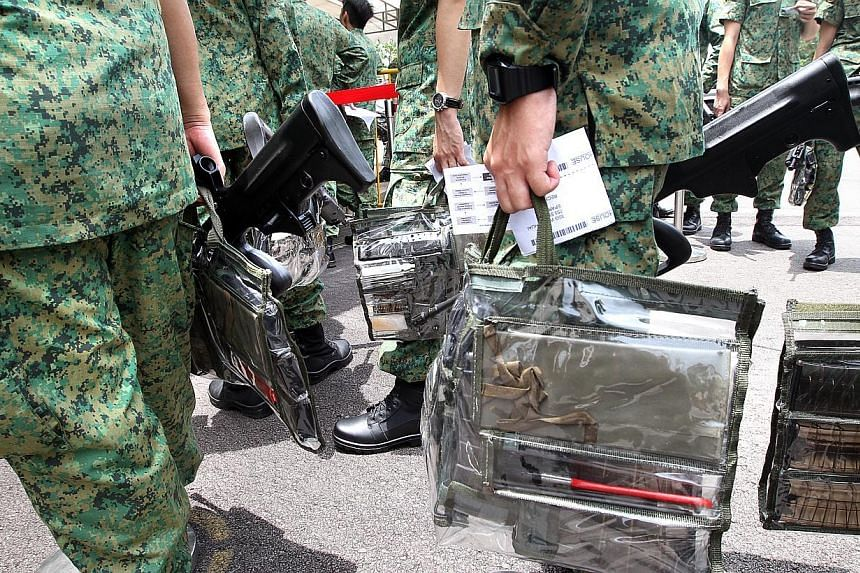 NSmen get ready during the call up for mobilisation at Nee Soon Camp. -- ST PHOTO: CHEW SENG KIM