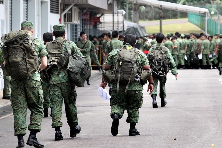 NSmen, called up for mobilisation, at Nee Soon Camp. -- ST PHOTO: CHEW SENG KIM