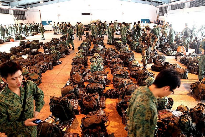 NSmen, called up for mobilisation,at Nee Soon Camp.Citizen soldiers are spending less than half the time on administrative processes than they were four years ago thanks to recent improvements in mobilisation exercises.-- ST PHOTO: