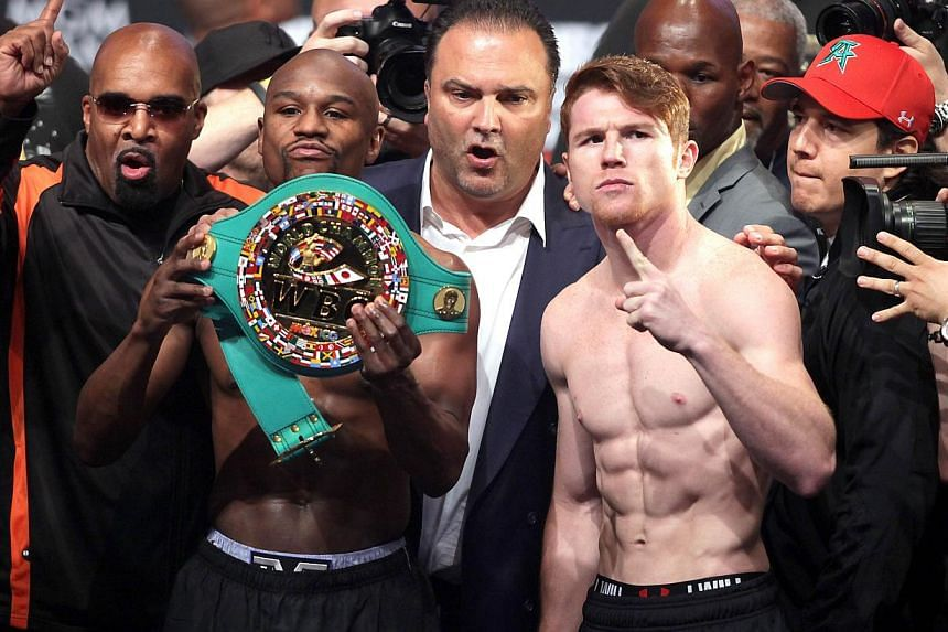 Boxers Floyd Mayweather Jr. (2nd left) of the US and Canelo Alvarez (2nd right) of Mexico pose during the official weigh-in for their bout at the MGM Grand Garden Arena on Sept 13, 2013 in Las Vegas, Nevada.Mayweather, who is fighting twice in