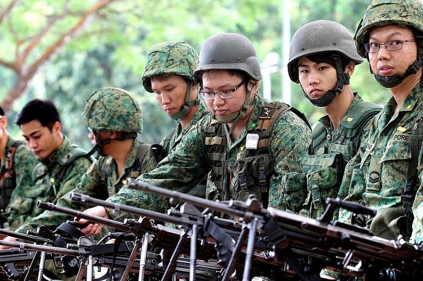 NSmen called up for mobilisation, having their weapon inspection before the live firing exercise at Nee Soon Camp.Families matter as much as serving the nation - so NSmen should get time off from their annual in-camp training to attend importan