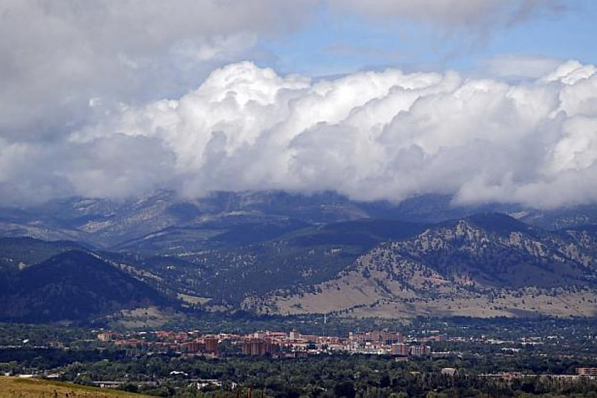 Storm clouds build over Boulder, Colorado, and the Rocky Mountains on Sept 13, 2013. Taking advantage of a break in record rains that caused Colorado's worst flooding in over three decades, United States National Guard members streamed into the remot