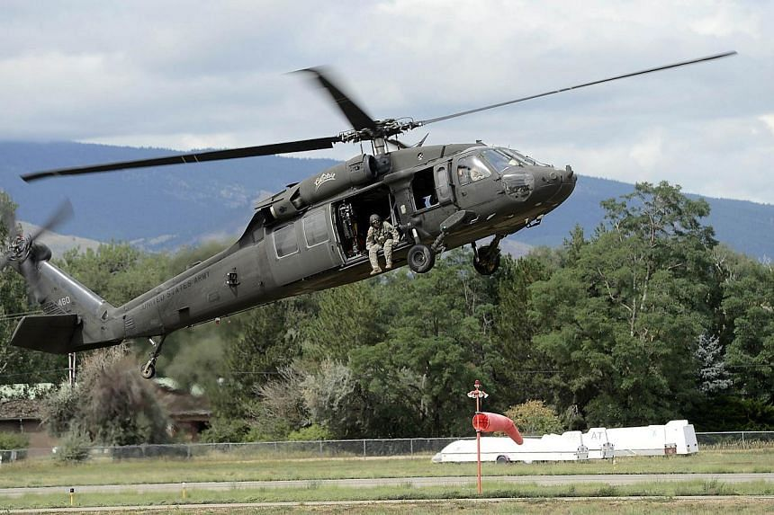 A National Guard helicopter lands at Boulder Municipal Airport after ferrying supplies and rescue personnel to mountain towns that have been cut off by the flooding in Boulder, Colorado, on Sept 13, 2013. The National Guard worked to rescue an entire