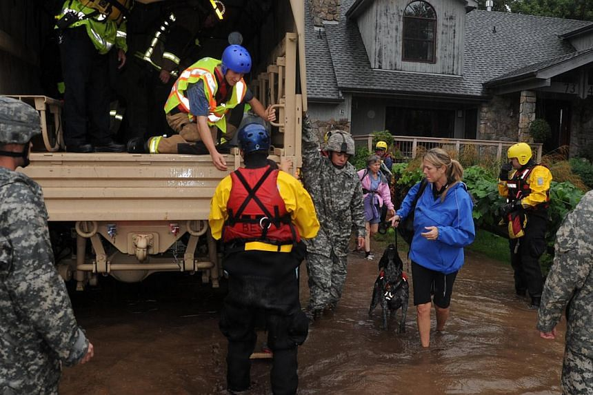 Colorado National Guardsmen respond to floods in Boulder County, Colorado, in this handout photo provided by the Army National Guard and taken on Sept 12, 2013. The National Guard on Friday evacuated a Colorado town cut off by raging floodwaters, whi