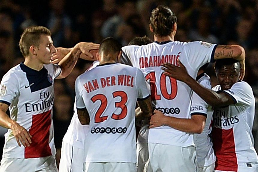Paris Saint-Germain forward Zlatan Ibrahimovic (second right) celebrates with teammates after PSG midfielder Blaise Matuidi scored a goal during the French L1 football match between FC Girondins de Bordeaux and Paris Saint-Germain on Sept 13, 2013, a