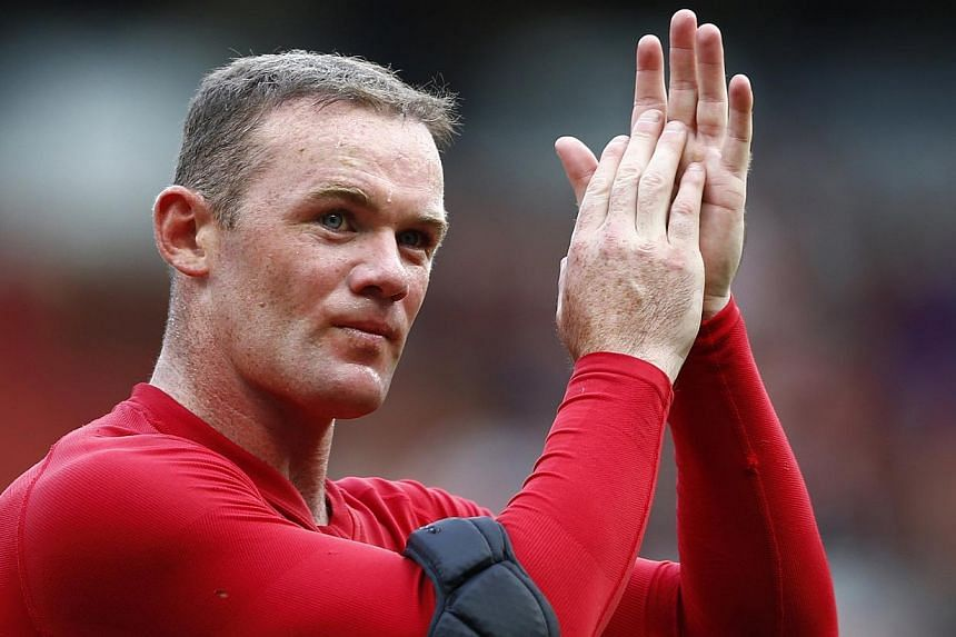 Manchester United's Wayne Rooney applauds after their English Premier League soccer match against Crytstal Palace at Old Trafford in Manchester, northern England on Sept 14, 2013.Rooney returned from injury to give Manchester United manager Dav