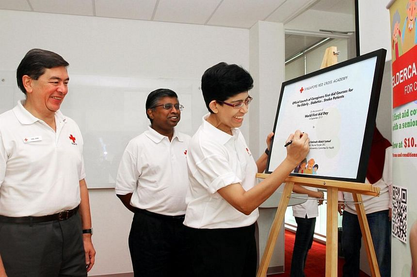 (From left) Vice Chairman of Singapore Red Cross (SCR)Axel Chan, Secretary General of SRCBenjaminJeyarajWilliamandmember of parliament and deputy chairman for the Government Parliamentary Committee for Health Fatim