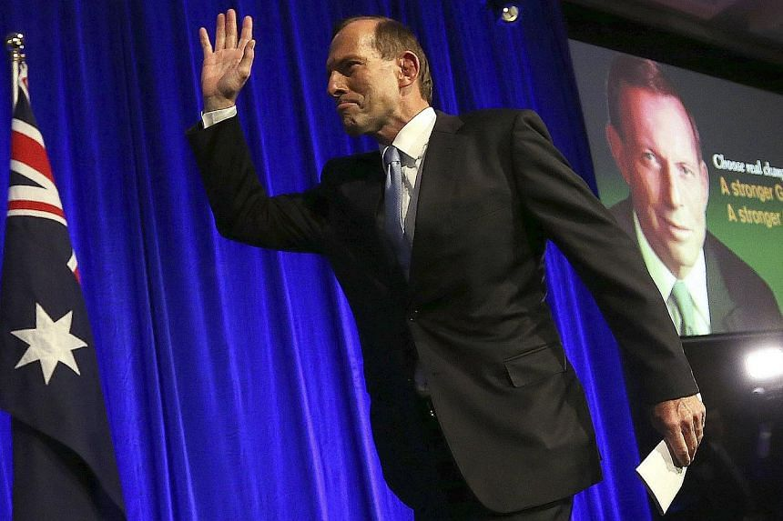 Australia's conservative leader Tony Abbott arrives to the stage to claim victory at an election night function in Sydney on Sept 7, 2013. The United States expects smooth relations with Australia's Prime Minister-elect Tony Abbott, but it remains to