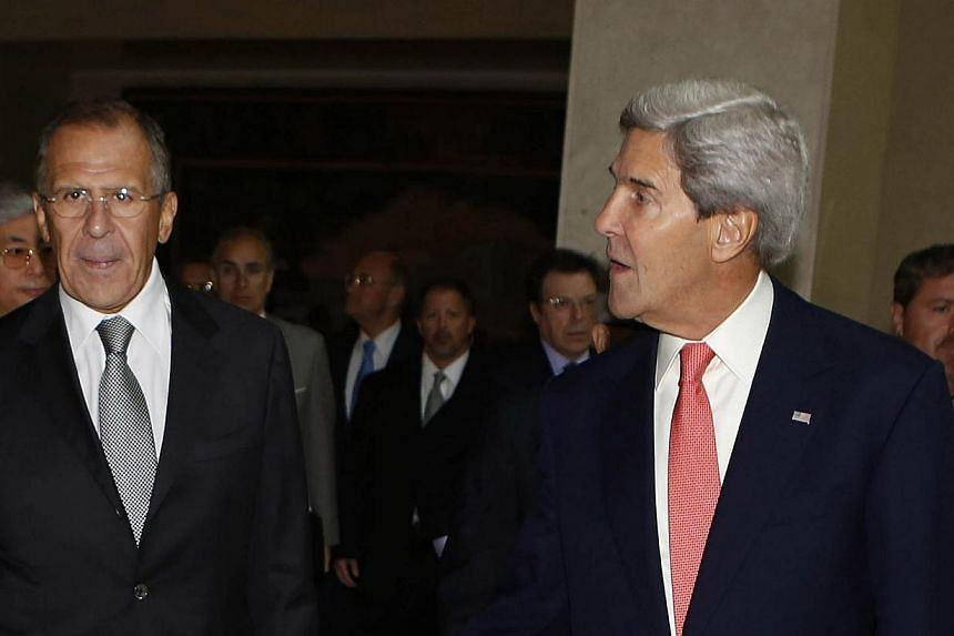 United States Secretary of State John Kerry (right) Russian Foreign Minister Sergey Lavrov walk along with the United Nations-Arab League envoy for Syria, Mr Lakhdar Brahimi (not in photo) into a meeting at the UN offices in Geneva to discuss the ong