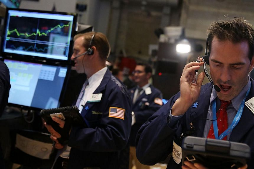 Traders work on the floor of the New York Stock Exchange in New York on Sept 11, 2013. United States stocks rose on Friday and the Dow registered its best weekly gain since January, helped by gains in Intel, though trading was subdued as the Federal