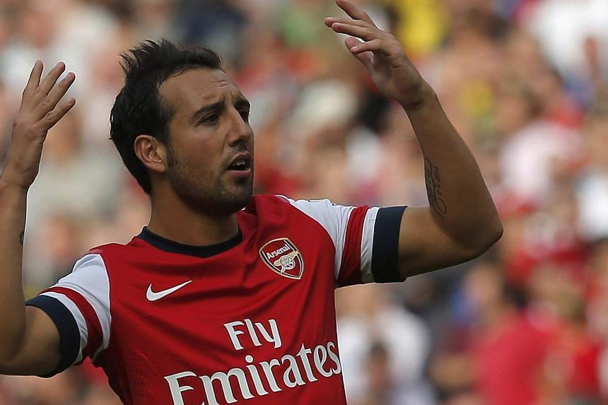Arsenal's Santi Cazorla reacts after going close with a free kick during their English Premier League soccer match against Tottenham Hotspur at the Emirates, London, England September 1, 2013. Arsenal manager Arsene Wenger revealed on Saturday that S