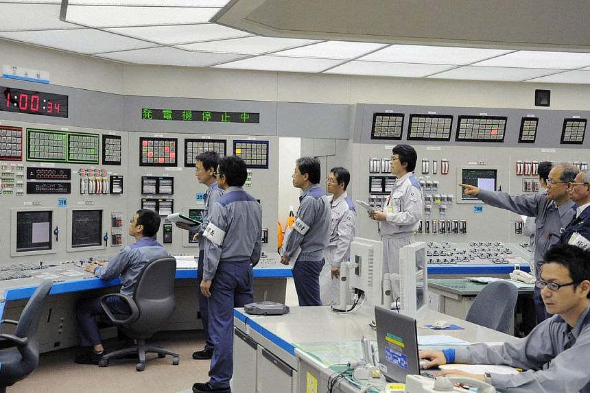 Workers of Kansai Electric Power Co's Ohi nuclear power plant monitors the restart of the No. 3 unit in Ohi, Fukui prefecture, in this file photo taken by Kyodo on July 1, 2012. Japan is set to be nuclear power-free, for just the third time in more t