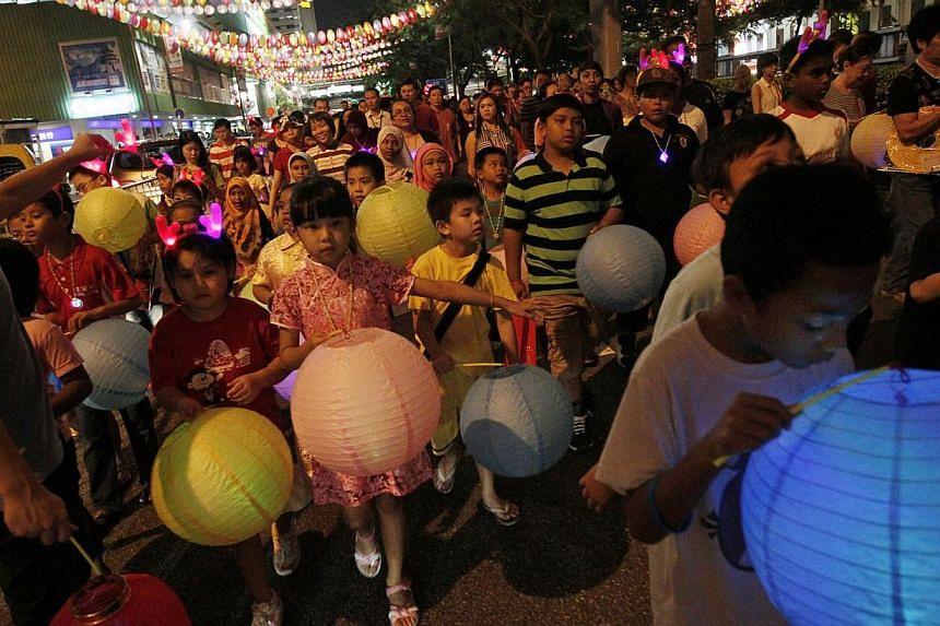 Children carry lanterns during the Chinatown Mid-Autumn Festival 2013 Mass Lantern Walk on Sept 15, 2013.