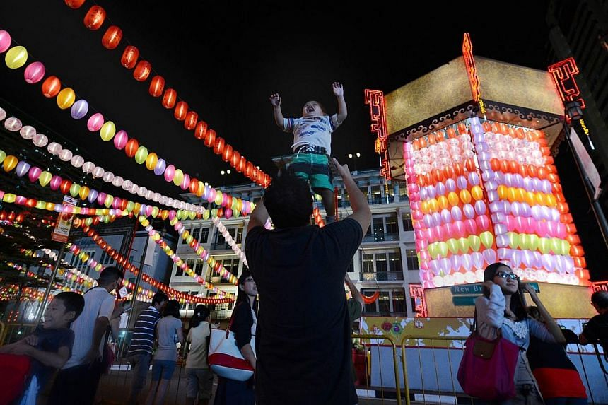 Thousands gathered in Chinatown on Sunday night to celebrate the Mid-Autumn Festival, which falls on Sept 19 this year. -- ST FILE PHOTO: NG SOR LUAN