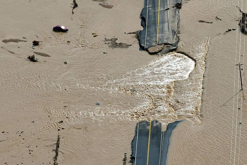A section of highway is washed out by flooding along the South Platte River in Weld County, Colorado near Greeley, Saturday, Sept 14, 2013. Hundreds of roads in the area have been damaged or destroyed by the floodwaters that have affected parts of a