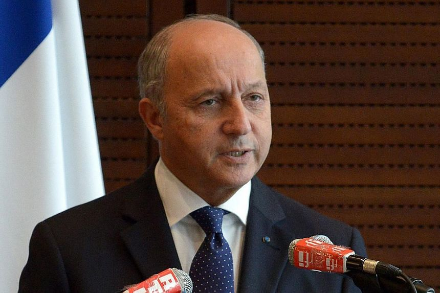 French Foreign Minister Laurent Fabius speaks during a press conference at the French Embassy in Beijing on Sunday, Sept 15, 2013. Mr Fabius said a Russia-US deal to remove Syrian President Bashar al-Assad's chemical weapons was an important fir