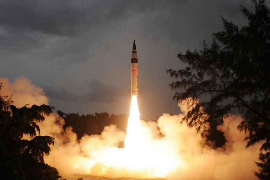 This photograph shows the launch of an Agni V intercontinental ballistic missile at Wheeler Island, India's Orissa state, on September 15, 2013, released by India's Defence Research and Development Organisation (DRDO). India successfully test-fired f