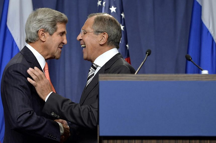 US Secretary of State John Kerry (left) and Russian Foreign Minister Sergei Lavrov shake hands after making statements following meetings regarding Syria, at a news conference in Geneva on Saturday, Sept 14, 2013. The deal between the United Sta