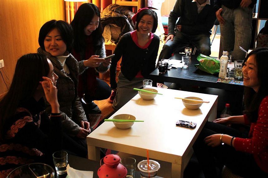 Ms Sandra Bao (fourth from left) at a social event organised by the Singles Cub in Shanghai earlier this year. Founded in 2010, the online community acts as a support group for single women, bringing them together through events such as movie nights.